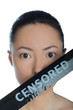 Asian with taped mouth