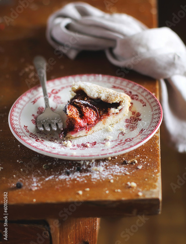 Homemade rustic pie with ripe figs, raspberry