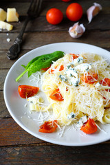 appetizing  pasta with cheese and tomatoes