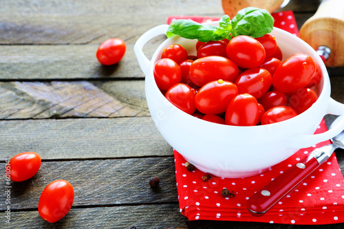 fresh tomatoes in a white tureen