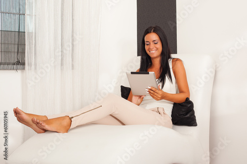 Beautiful woman using a digital tablet