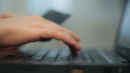 Woman's hands are typing something on laptop