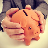 man in suit with a piggy bank