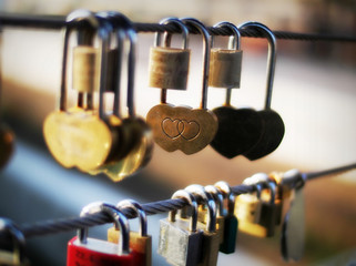 Close-up of heart shape padlock on bridge railing, Ljubljana