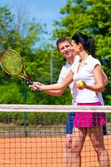 Tennis sport teacher teaching woman to play