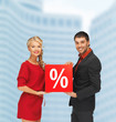 smiling man and woman with percent sign