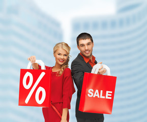 smiling man and woman with shopping bag