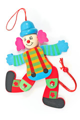 Mechanical clown toy on string  isolated on white