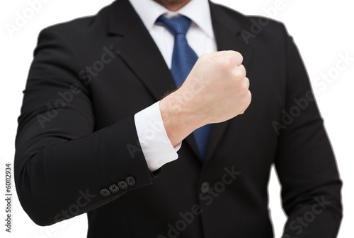 businessman showing something at his hand