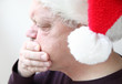 nauseated senior in holiday hat