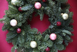 ornaments and bells on fresh Christmas wreath