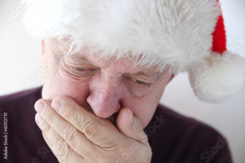 senior in Santa hat has nausea