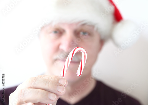 older man with candy cane