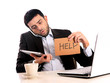 Businessman overworked at office