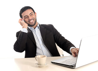 relaxed businessman working with computer and mobile