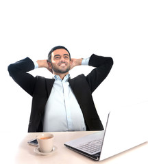 Businessman with computer relaxed and happy