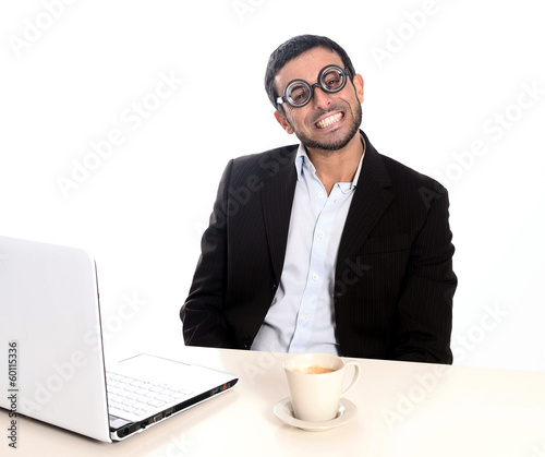 Nerd businessman in funny glasses working with computer