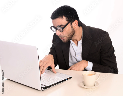 Nerd businessman in funny glasses at work