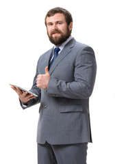 Businessman with tablet pc on a white background
