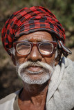India, Jaipur, indian man in one of the Galta hindu temples