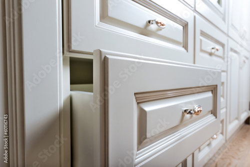 beautiful cabinet with drawers in a modern room - 60116743