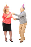 Full length portrait of mature couple dancing on a party