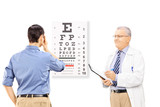 Young male patient taking eyesight test and an optician holding
