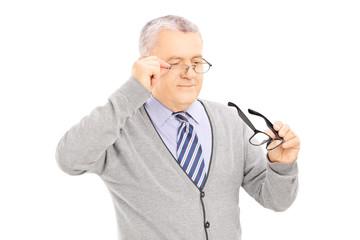 Senior gentleman trying on new pair of glasses