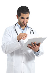 Arab doctor man reading a medical history