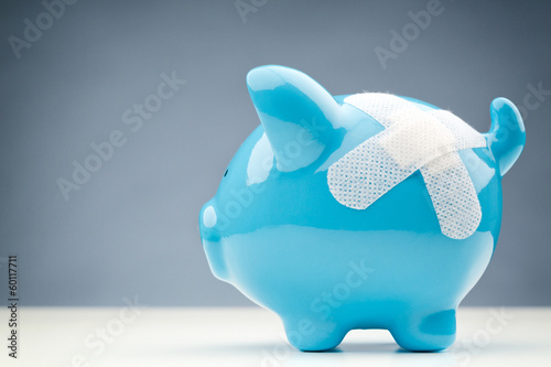 Savings Risk or Danger - Bandaged Piggy Bank