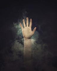 Hand in smoke