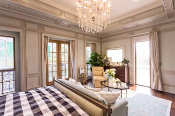 Modern bedroom with wooden floor and big window