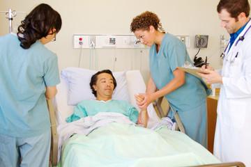 Nurse examing patients arm