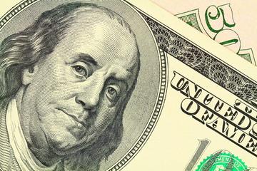 Macro shot of a 100 dollar. Benjamin Franklin on the bill