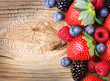 Berries on Wooden Background. Strawberries and Blueberry
