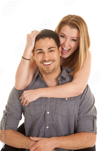 Woman on mans back laugh
