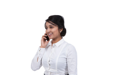 Side view of an Asian businesswoman talking on cell phone