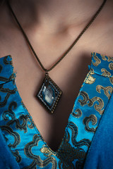 amulet on a neck at sorceress closeup