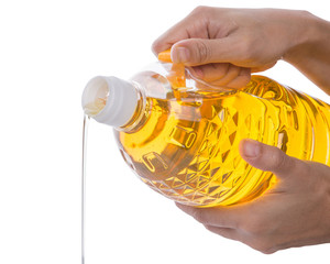 Female Hands Pouring Vegetable Oil