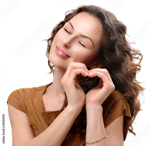 Woman in love showing Heart with her Hands. St. Valentine's Day