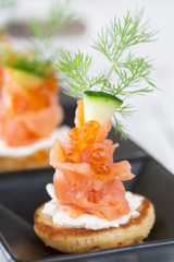 Smoked salmon and sour cream appetiser, garnished with dill. Clo