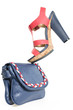 Pare of trendy navy blue and pink shoes, with matching bag, on w