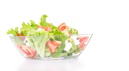 Mixed salat in a glass bowl isolated on white