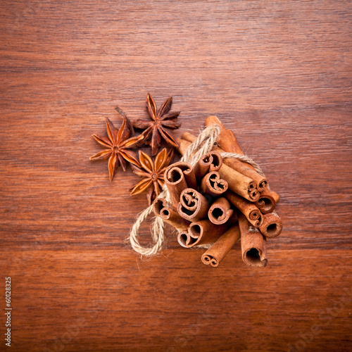 cinnamon sticks and star anise on a wooden background