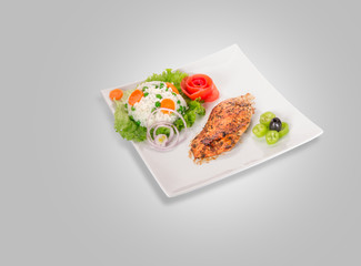 Chicken fillet on plate isolated on gray