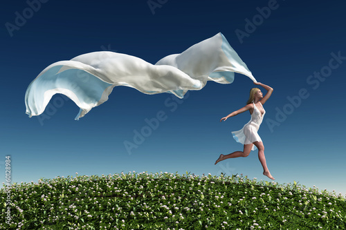 woman running on the green grass