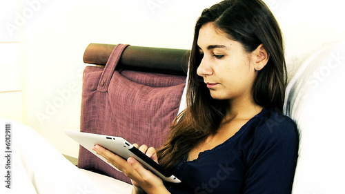 Woman writing email on tablet