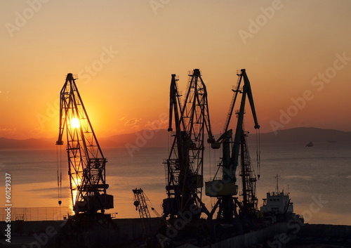 Silhouettes of gantries. Sunrise