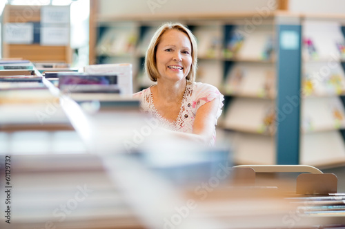 Confident Librarian Working In Library
