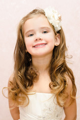 Happy adorable little girl in princess dress